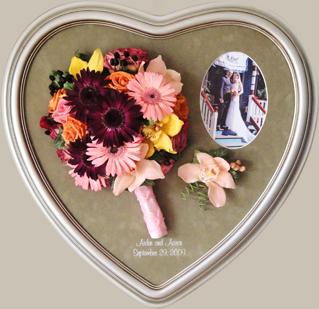 Preserved floral keepsake in a heart frame.